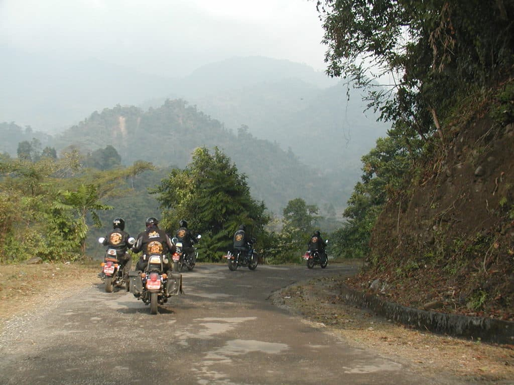 The Tarayana Dragons Motorcycle Club riding through the mountains of Bhutan